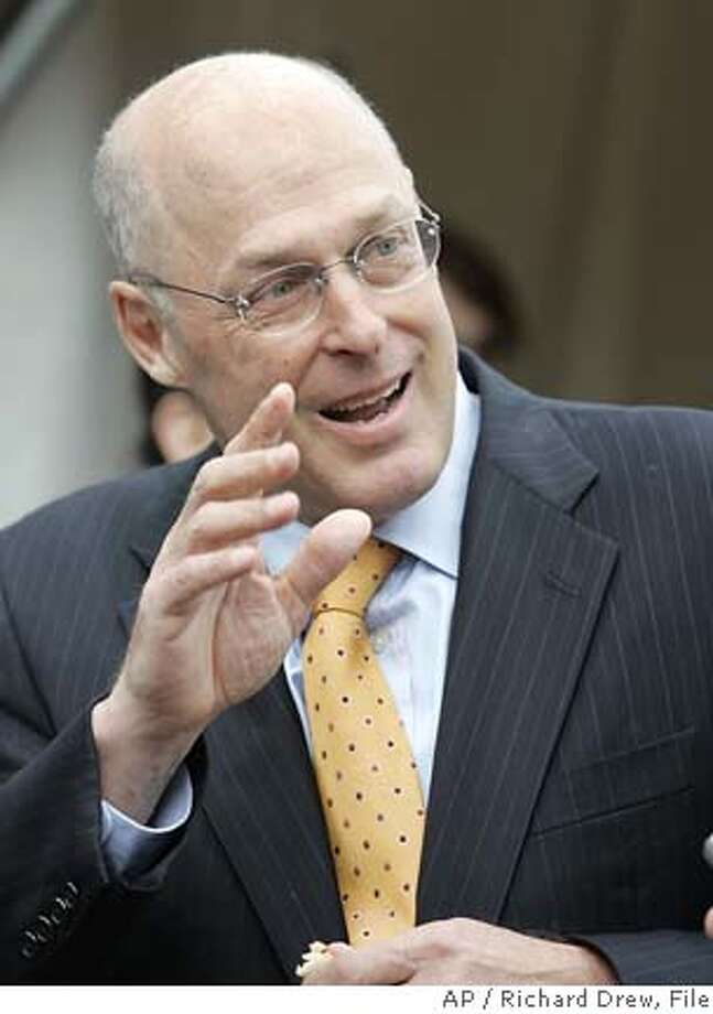** FILE ** Henry Paulson, Goldman Sachs chairman and CEO, arrives at ground breaking ceremonies for his company's new headquarters, in New York, in this Nov. 29, 2005 file photo. Goldman Sachs has risen to become one of the top firms, if not the top, on Wall Street, and its stock movement reflects that. The company is expected to earn $3.30 per share, up from $2.36 per share in the fourth quarter of 2004, when it releases its results Thursday morning. (AP Photo/Richard Drew, File) Ran on: 12-25-2005  John Mack will take home $11.5 million for four months of work as CEO of the Morgan Stanley brokerage house. Photo: RICHARD DREW