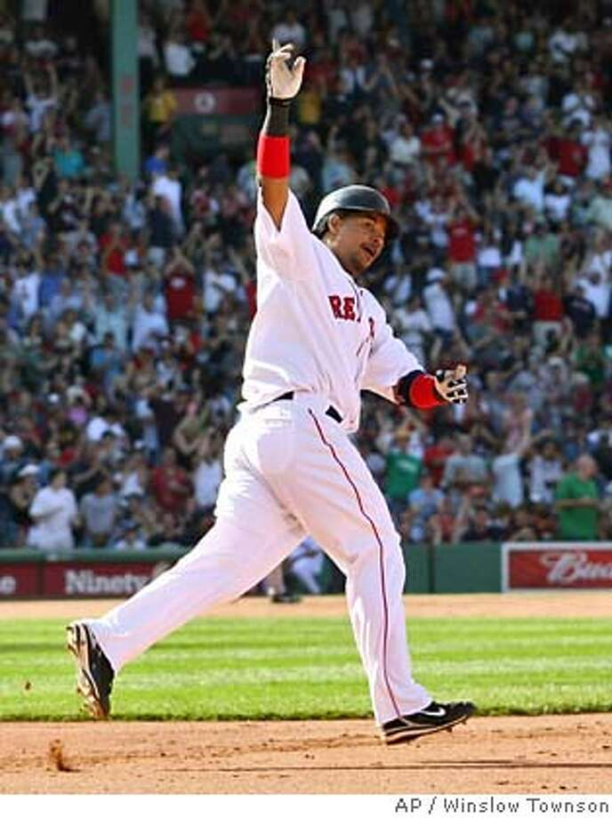 ** RETRANSMISSION FOR IMPROVED TONING ** Boston Red Sox's Manny Ramirez rounds the bases after his solo home run against the San Fransisco Giants during the fourth inning in their baseball game at Fenway Park in Boston Saturday, June 16, 2007. (AP Photo/Winslow Townson) Photo: Winslow Townson