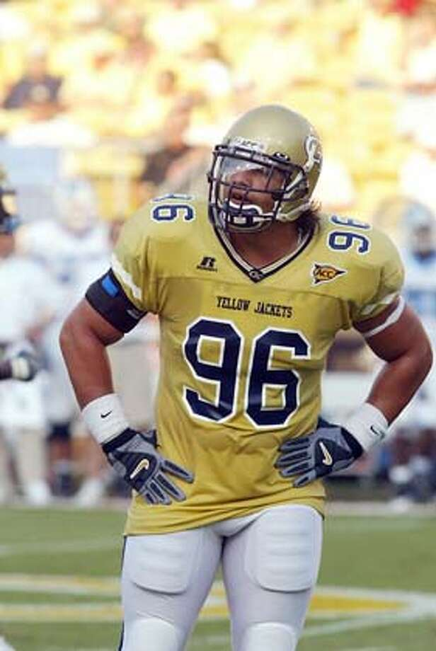 Joe Anoai, Georgia Tech, 2005. Credit: None, handout Ran on: 12-25-2005  Joe Anoai, a defensive tackle for Georgia Tech, says he might try pro wrestling, like his dad and uncle, if he doesn't make the NFL. Above, Anoai (center) huddles with his uncle, Afa (second from right), who with Anoai's father (back row with hat) performed as the Wild Samoans tag team in the '80s. Ran on: 12-25-2005 Ran on: 12-25-2005 Ran on: 12-25-2005 Ran on: 12-25-2005  Joe Anoai, a defensive tackle for Georgia Tech, says he might try pro wrestling, like his dad and uncle, if he doesn't make the NFL. Above, Anoai (center) huddles with his uncle, Afa (second from right), who with Anoai's father (back row with hat) performed as the Wild Samoans tag team in the '80s. Photo: Handout