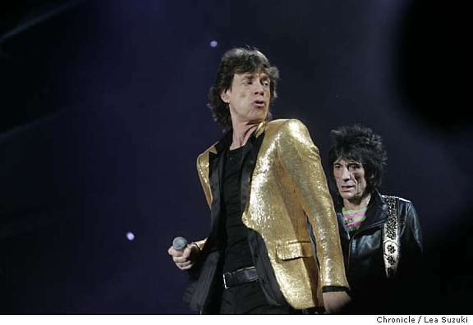 "rollingstones038_ls.JPG  from left: Mick Jagger, Ron Wood of the Rolling Stones perform at SBC. Rolling Stones perform at SBC. Two song limit - one from 70 feet back, other in pit.  Ticket Pick-Up (1 ticket) ROLLING STONES ""A BIGGER BANG WORLD TOUR"" Sunday, November 13, 2005 San Francisco, Calif. SBC Park Meeting Times: 5:30 pm to see opening act, Everclear 6:15pm to see opening act, Metallica 8:00pm for the Stones Location: Corner of 2nd and King Street, Side closest to the venue, under large South Beach Harbor sign Photo taken on 11/13/05 in San Francisco, CA. Photo by Lea Suzuki/ The San Francisco Chronicle /MAGAZINES OUT Photo: Lea Suzuki"
