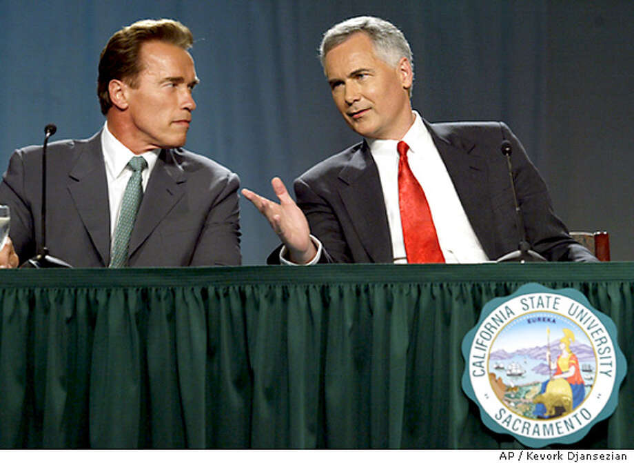 ARNOLD SCHWARZENEGGER AND TOM MCCLINTOCK TALK PRIOR TO GOVERNOR DEBATE Photo: POOL