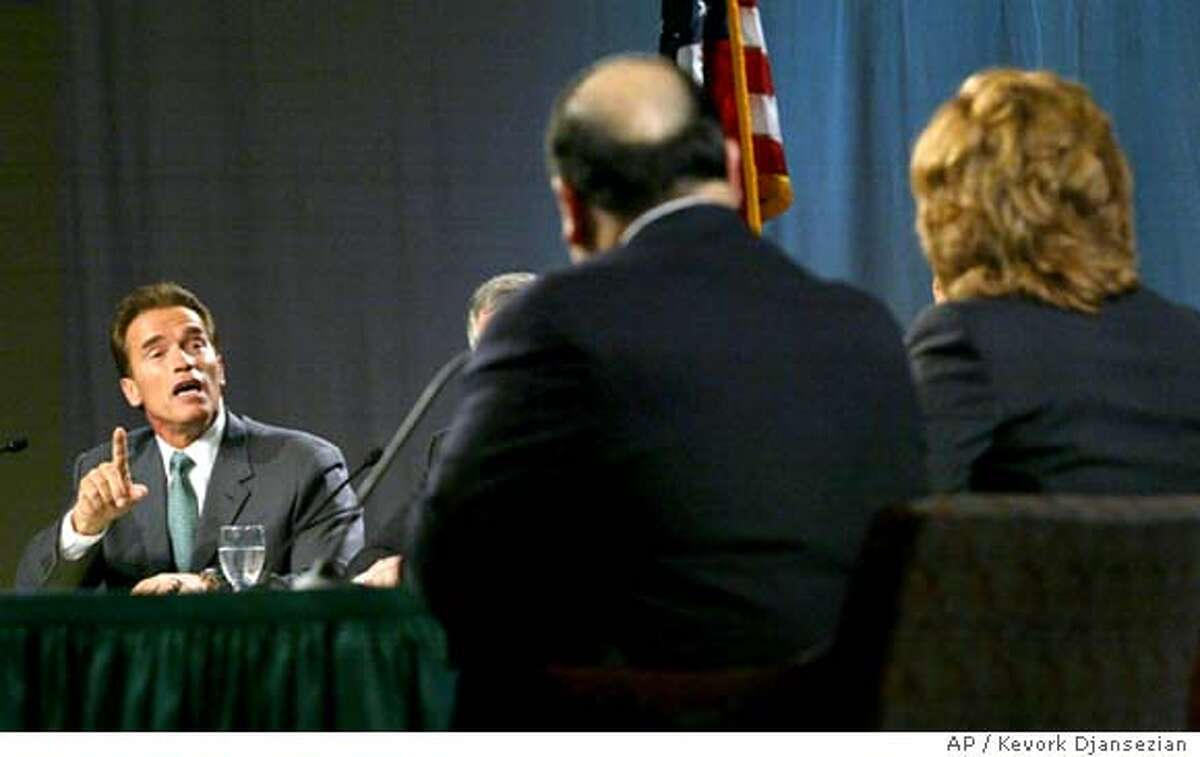 Republican Arnold Schwarzenegger, left, responds to a point made by Independent Arianna Huffington, back to camera right, during a televised debate between the five top candidates vying to replace Gov. Gray Davis at California State University in Sacramento, Calif., Wednesday, Sept. 24, 2003. (AP Photo/Kevork Djansezian)