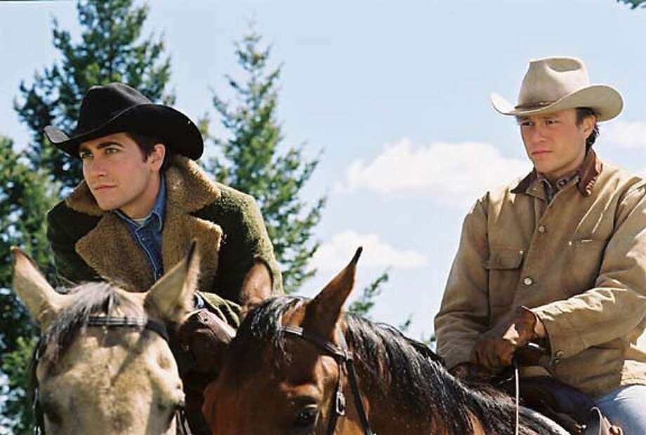 """An undated publicity photograph shows actors Jake Gyllenhaal (L) and Heath Ledger in a scene from their drama film """"Brokeback Mountain"""". The film received seven Golden Globe nominations, the most for any film, including best motion picture drama, as nominations were announced at a news conference in Beverly Hills December 13, 2005. The film centers on two men, played by Ledger and Gyllenhaal, who meet one summer as sheepherders in Wyoming and form a bond and love that spans 20 years. The film tracks that time period and their evolving gay relationship.The award show which honors excellence in film and television will be telecast to a worldwide audience from Beverly Hills January 16, 2006. NO ARCHIVES REUTERS/Focus Features/Handout 0 Photo: HO"""