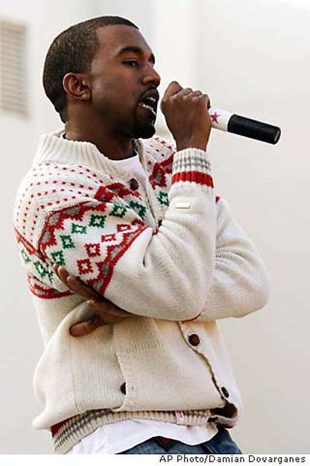 Kanye West performs Monday, Dec. 5, 2005, at Santa Monica High School in Santa Monica, Calif. West has partnered with retailer Musicland to launch a Free U. College Giveaway, a nationwide sweepstakes with a prize of $150,000 to be put toward the cost of the winner's four year college education. (AP Photo/Damian Dovarganes) STAND ALONE PHOTO Photo: DAMIAN DOVARGANES