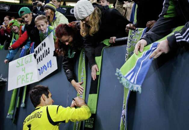 Seattle Sounders Goalie Michael Gspurning signs autographs after his game with the Toronto FC at CenturyLink Field in Seattle on Saturday, March 17, 2012. Photo: JOE DYER / SEATTLEPI.COM