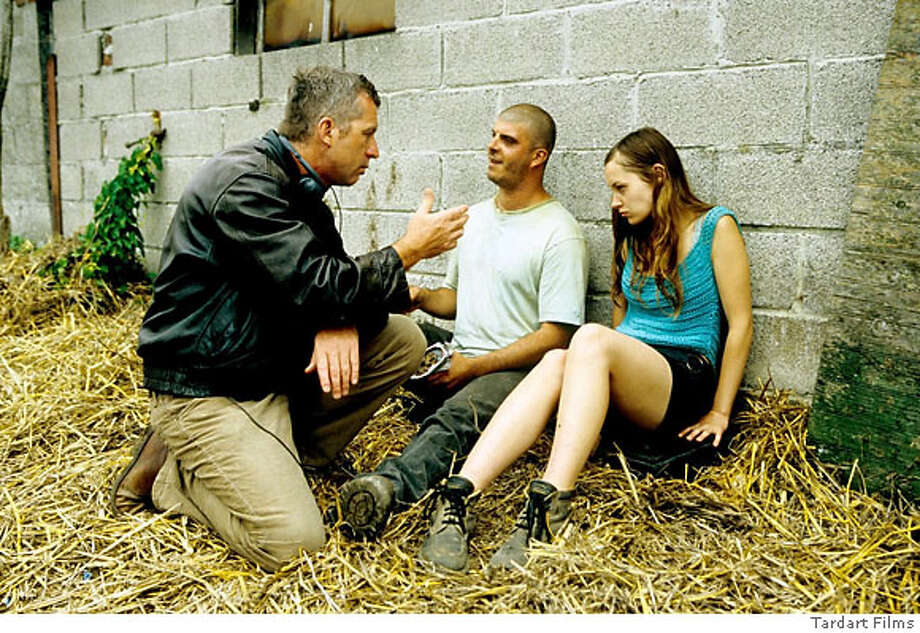 On the set of FLANDERS: Director Bruno Dumont, actors Samuel Boidin and Adelaide Leroux Ran on: 06-17-2007  Director Bruno Dumont with Samuel Boidin and Ad�la�de Leroux, nonprofessional actors who play lovers in &quo;Flanders.&quo; Photo: Tardart Films