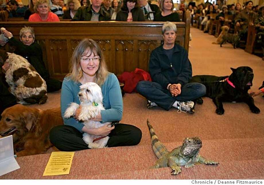dogblessings17_0042_df.jpg  Julianne Richter (cq) waited for her poodle, Skipper, and iguana, Harlie to be blessed at the Blessing of Animals at the National Shrine of Saint Francis of Assisi in North Beach. Photographed in San Francisco on 6/16/07. Deanne Fitzmaurice / The Chronicle Mandatory credit for photographer and San Francisco Chronicle. No Sales/Magazines out. Photo: Deanne Fitzmaurice