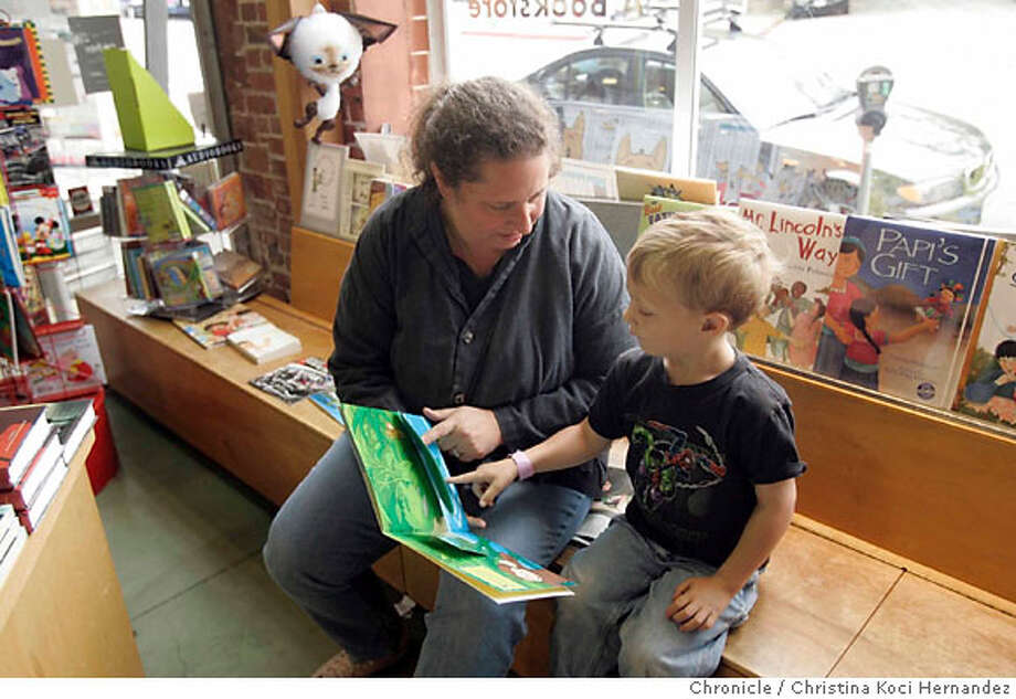 Customer Barbara Schultz reads to son, Joey Hollingsworth, age 4 1/2.Story is a profile of Diesel: A Bookstore, an independent bookstore with two locations in Rockridge (Oakland) and Malibu. It is the first in an occasional series of behind-the-scenes looks at what it takes to run different kinds of small businesses.. .(Christina Koci Hernandez/The Chronicle) Ran on: 06-17-2007  Barbara Schultz reads to her son, Joey Hollingsworth, 4�, in the children's section at Diesel: A Bookstore in Oakland's Rockridge neighborhood.  Ran on: 06-17-2007  Barbara Schultz reads to her son, Joey Hollingsworth, 4, in the children's section at Diesel: A Bookstore in Oakland's Rockridge neighborhood. Photo: Christina Koci Hernandez/CHRONIC