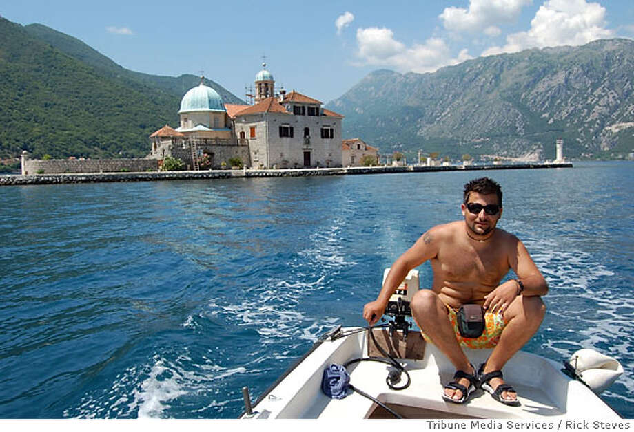 On the Bay of Kotor, young men motor travelers out to �Our Lady of the Rocks� Church.  Photo credit: Rick Steves Photo: Rick Steves