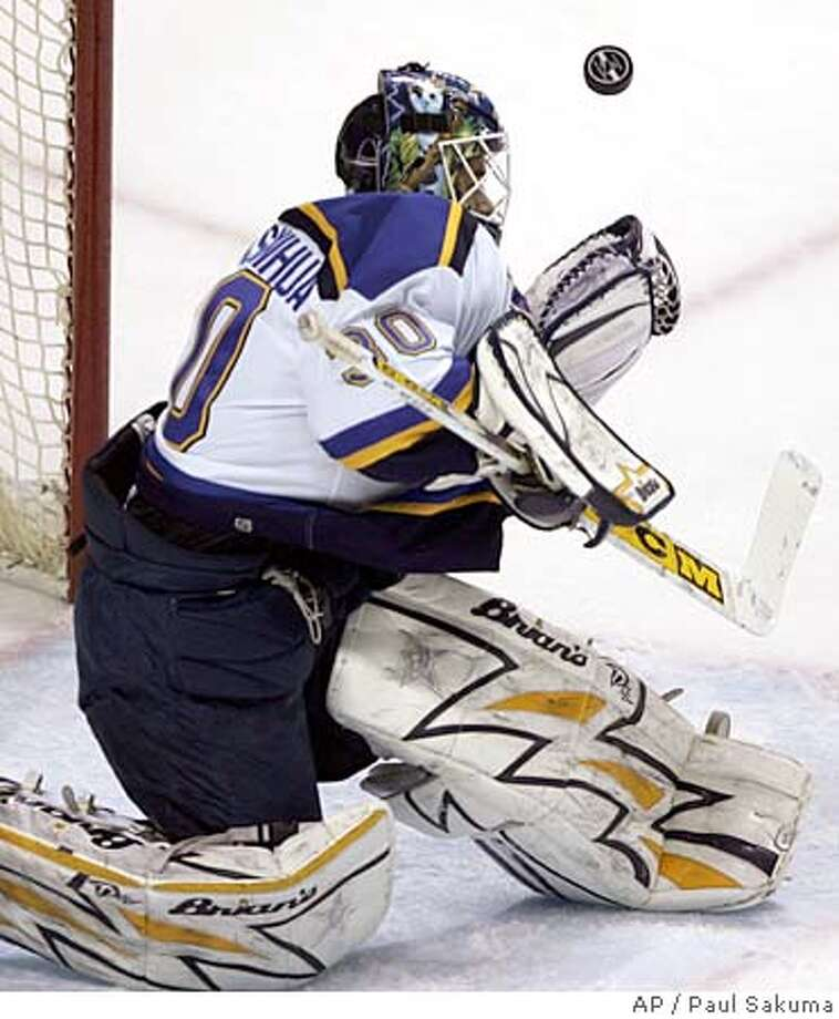 St. Louis Blues goalie Jason Bacashihua blocks a San Jose Sharks shot during the first period of an NHL hockey game Friday, Dec. 23, 2005, in San Jose, Calif. (AP Photo/Paul Sakuma) Photo: PAUL SAKUMA