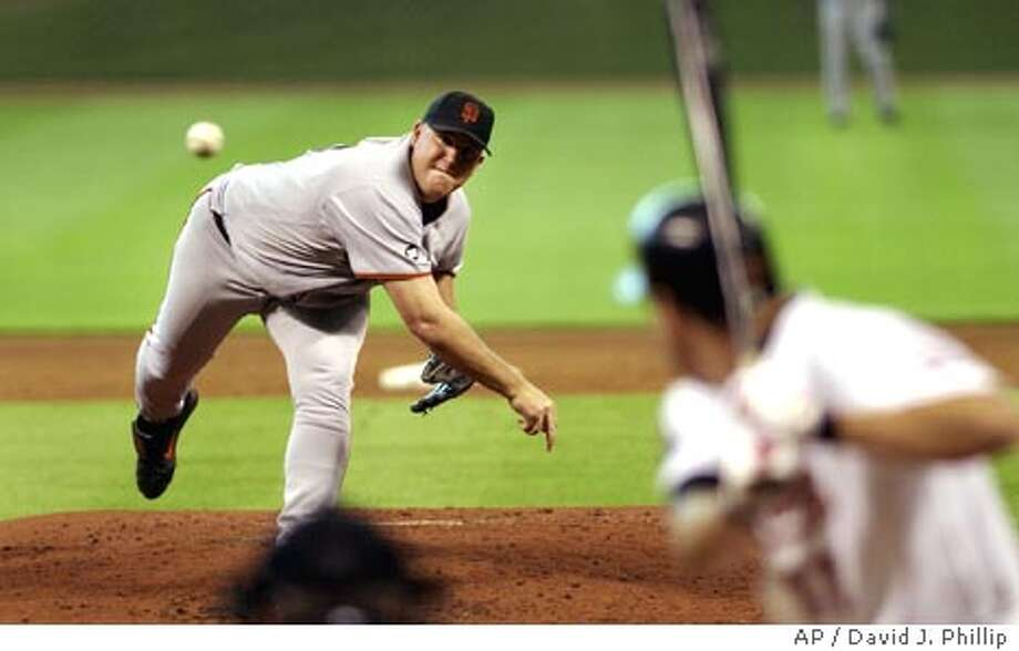 San Francisco Giants pitcher Sidney Ponson, left, delivers a pitch to Houston Astros' Lance Berkman, right, during the fifth inning Wednesday, Sept. 24, 2003 in Houston. (AP Photo/David J. Phillip) Photo: DAVID J. PHILLIP