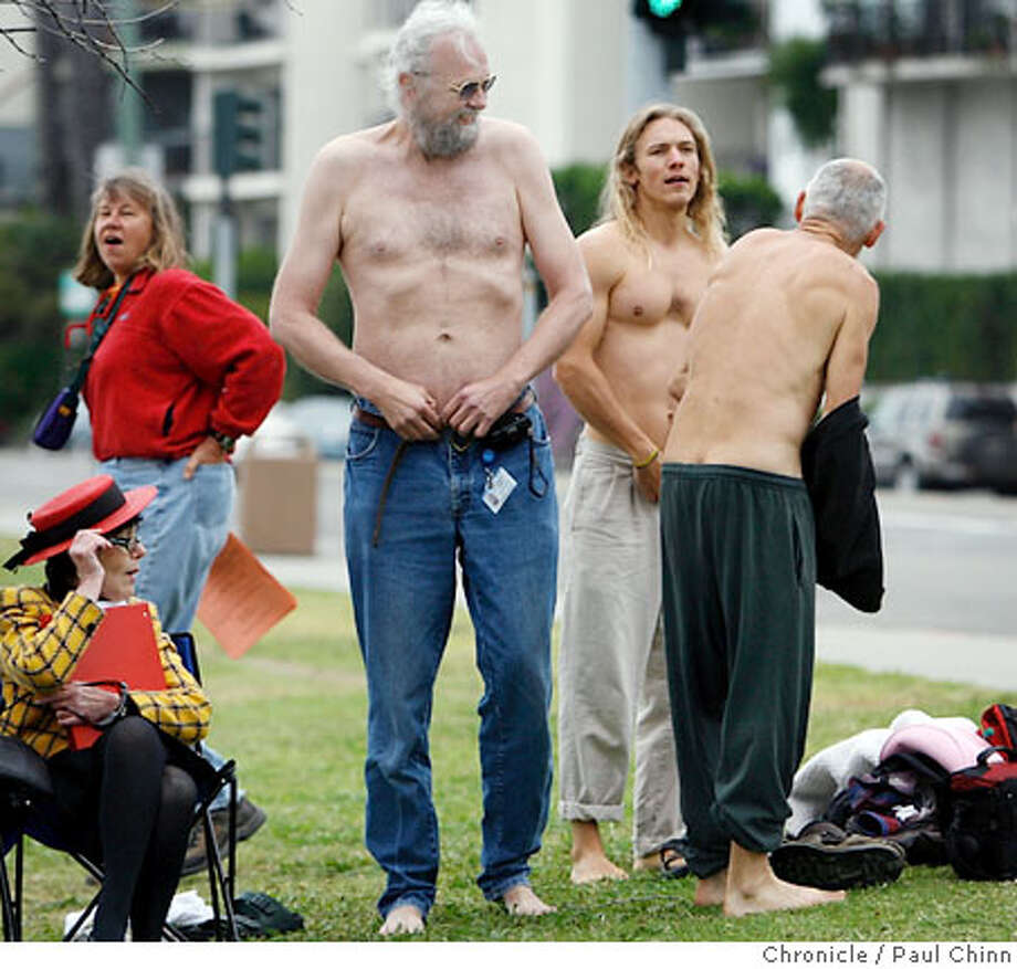 Volunteers stripped down to the bare essentials before being photographed naked surrounding a eucalyptus tree on Lakeshore Avenue at Lake Merritt in Oakland, Calif. on Saturday, June 16, 2007. Photographer Jack Gescheidt recruited the models to protest the city's planned cutting of over 200 trees along the lakefront for a landscaping improvement plan. Among Gescheidt's previous photo sessions for his Tree Spirit Project includes nudes surrounding the grove of trees at Memorial Stadium at UC Berkeley in March. PAUL CHINN/The Chronicle  **Jack Gescheidt Photo: PAUL CHINN