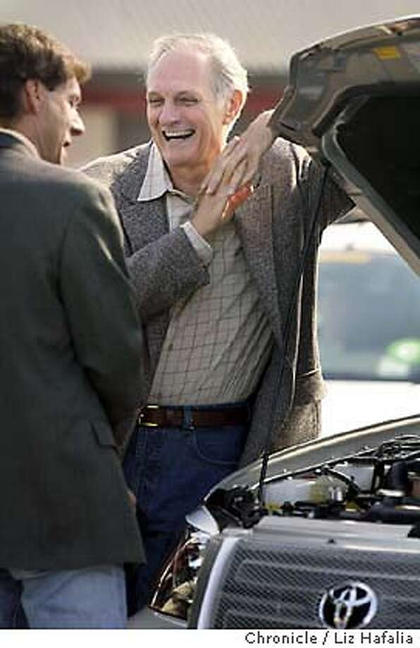 The fifth annual Challenge Bibendum, an event showcasing environmentally friendly cars, at Infineon Raceway. The event has drawn 106 cars from 15 manufacturers. Actor Alan Alda at the event doing a PBS show for Scientic American Frontiers.  Event on 9/24/03 in Sonoma. LIZ HAFALIA / The Chronicle Photo: LIZ HAFALIA