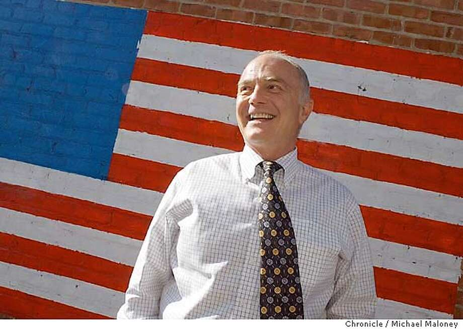 Paul Mariano is a deputy public defender in Contra Costa County and a candidate for governor. If elected, he would appoint Gray Davis chief of staff and let him run the state. Mariano is photographed in front of a flag painted on a near by building in Martinez. Event on 9/15/03 in Martinez.  MICHAEL MALONEY / The Chronicle Photo: MICHAEL MALONEY