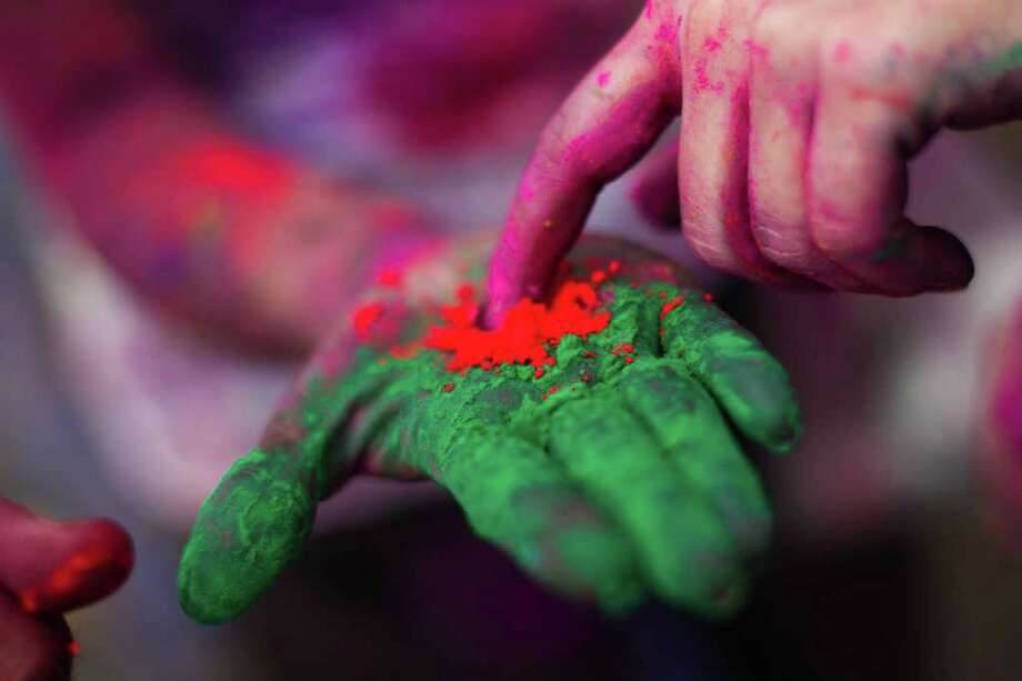Indian devotee display coloured powder during 'Holi' at a temple in Kuala Lumpur on March 18, 2012. Photo: MOHD RASFAN, AFP/Getty Images / AFP