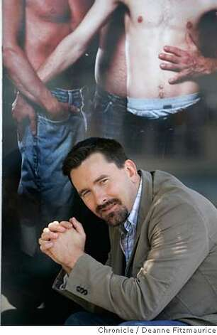 daddyhunt_0200_df.jpg  Christopher Turner, 35, poses in front of a poster advertising his new website, daddyhunt.com which matches young gay men with older males. Deanne Fitzmaurice / The Chronicle Mandatory credit for photographer and San Francisco Chronicle. No Sales/Magazines out. Photo: Deanne Fitzmaurice