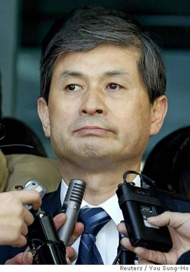 South Korean stem-cell scientist Hwang Woo-suk talks to reporters as he leaves his office at the Seoul National University in Seoul December 23, 2005. The results of a landmark 2005 paper on producing tailored embryonic stem cells were intentionally fabricated and the main scientist should shoulder the blame, a South Korean investigation panel said on Friday. REUTERS/You Sung-Ho 0 Photo: YOU SUNG-HO