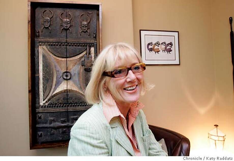 .jpg SHOWN: Cheryl DuCote, an interior architect and designer, in the Reference Room of Michael Woods's showroom, with an old granary door from Camaroon on the wall behind her. The story is about how Cheryl DuCote, an interior architect and designer, turned a Victorian full of small spaces into an intimate sound and video showroom for Michael Woods when he decided to market the most highly acclaimed audio system. These pictures were made in San Francisco, CA. on Thursday, May 24, 2007. (Katy Raddatz/The Chronicle)  **Michael Woods, Cheryl DuCote Mandatory credit for the photographer and the San Francisco Chronicle. No sales; mags out. Photo: Katy Raddatz