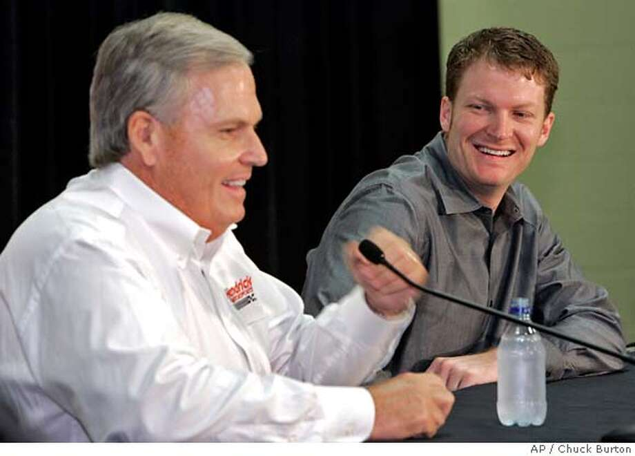 Dale Earnhardt Jr, right, shares a laugh with team owner Rick Hendrick, left, during a news conference in Mooresville, N.C., Wednesday, June 13, 2007. Dale Earnhardt Jr. is joining Hendrick Motorsports, hopefully moving one step closer to a championship that has eluded him while driving for his late father's company. (AP Photo/Chuck Burton) Photo: Chuck Burton