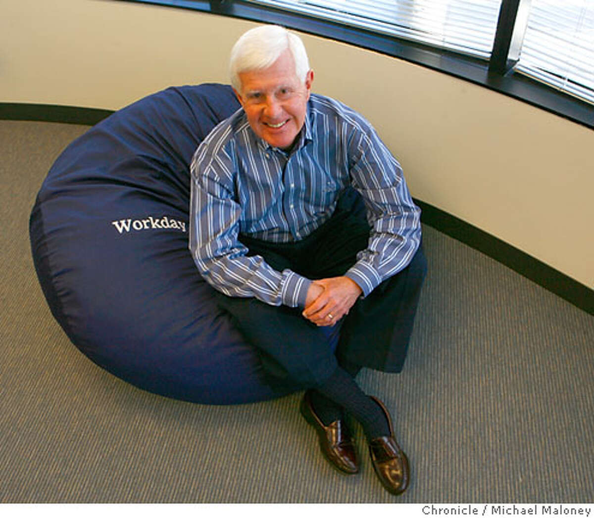 Dave Duffield poses in one of the bean bag chairs set up in the company's game room.After fighting the hostile takeover of his company, PeopleSoft, Dave Duffield founded a new startup in Walnut Creek with 107 employees called Workday. And that startup is taking bold aim at his old nemesis, Oracle's Larry Ellison, by selling software that lets companies manage business tasks via the Internet instead of installing costly programs on company computers. Photo by Michael Maloney / San Francisco Chronicle Photo taken on 6/8/07 in Walnut Creek, CA *** Ran on: 06-17-2007 David Duffield relaxes in a beanbag chair in the game room at Workday, where the congenial atmosphere is a reminder of his days at PeopleSoft. Ran on: 06-17-2007 David Duffield relaxes in a beanbag chair in the game room at Workday, where the congenial atmosphere is a reminder of his days at PeopleSoft.