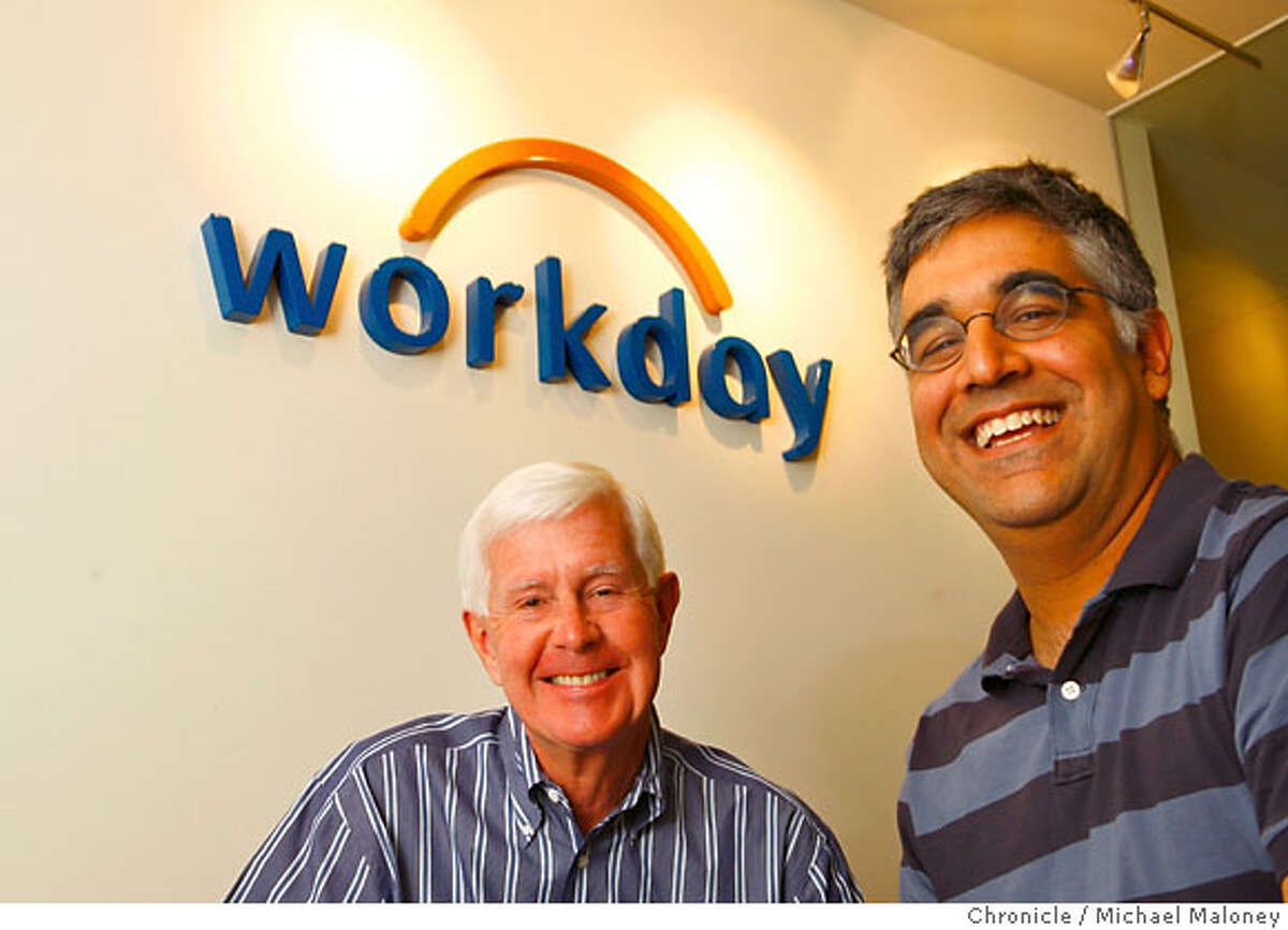 Dave Duffield, left and Aneel Bhusri (co-founder and president) pose in front of the company logo in the reception room of the Walnut Creek office. After fighting the hostile takeover of his company, PeopleSoft, Dave Duffield founded a new startup in Walnut Creek with 107 employees called Workday. And that startup is taking bold aim at his old nemesis, Oracle's Larry Ellison, by selling software that lets companies manage business tasks via the Internet instead of installing costly programs on company computers. Photo by Michael Maloney / San Francisco Chronicle Photo taken on 6/8/07 in Walnut Creek, CA *** Ran on: 06-17-2007 David Duffield relaxes in a beanbag chair in the game room at Workday, where the congenial atmosphere is a reminder of his days at PeopleSoft. Ran on: 06-17-2007 David Duffield relaxes in a beanbag chair in the game room at Workday, where the congenial atmosphere is a reminder of his days at PeopleSoft.