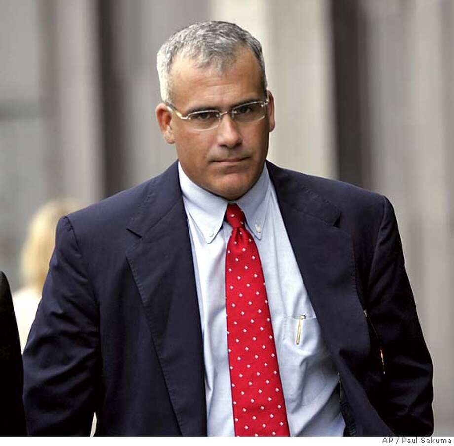 ** OMITS REFERENCE TO STEPHANIE JENSEN, WHO HAS NOT BEEN CRIMINALLY CHARGED ** Brocade's former CEO Gregory L. Reyes walks into a federal courthouse in San Francisco, Wednesday, Aug. 2, 2006. Reyes became the first chief executive to be criminally charged over alleged improper accounting of stock options. (AP Photo/Paul Sakuma)  Ran on: 08-03-2006  Brocade's former CEO Gregory Reyes walks into a federal courthouse in San Francisco to face securities fraud charges.  Ran on: 06-01-2007  Former Brocade chief executive Gregory Reyes still faces criminal fraud charges. OMITS REFERENCE TO STEPHANIE JENSEN, WHO HAS NOT BEEN CRIMINALLY CHARGED. STAND ALONE PHOTO Photo: PAUL SAKUMA