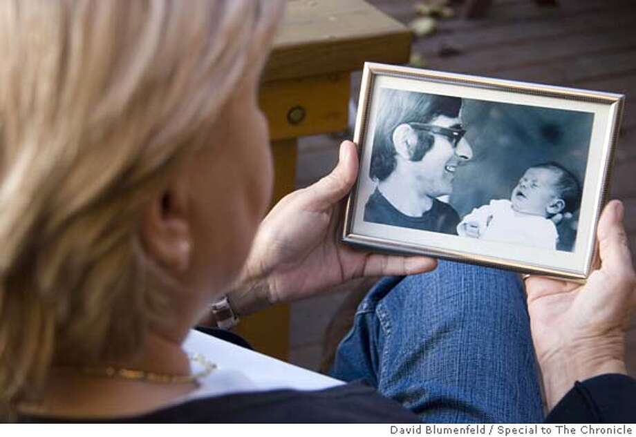 Ramat Hasharon, Israel: December 19, 2005: Ankie Spitzer, the wife of Andre Spitzer, one of the Israelis killed at the Munich Massacre at the 1972 Olympic Games holds a photo of her husband and their daughter, Anouk. Photo by David Blumenfeld/Special to The Chronicle Photo: David Blumenfeld/Special To The