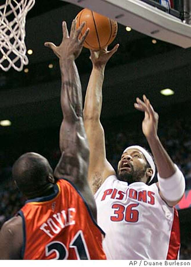 Detroit Pistons forward Rasheed Wallace (36) shoots against Golden State Warriors center Adonal Foyle, left, in the first half of an NBA basketball game Friday, Dec. 23, 2005, in Auburn Hills, Mich. (AP Photo/Duane Burleson) Photo: DUANE BURLESON