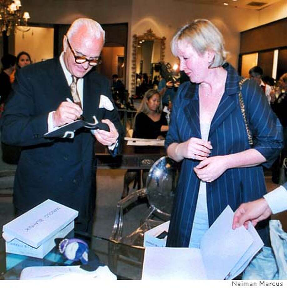 MANOLO BLAHNIK SIGNS ONE OF HIS SHOES FOR RUSSIAN PRINCESS LADA SCHUISKI, WHO LIVES IN THE STATE OF WASHINGTON AND OWNS MORE THAN 80 PAIRS OF BLAHNIKS. COURTESY: NEIMAN MARCUS