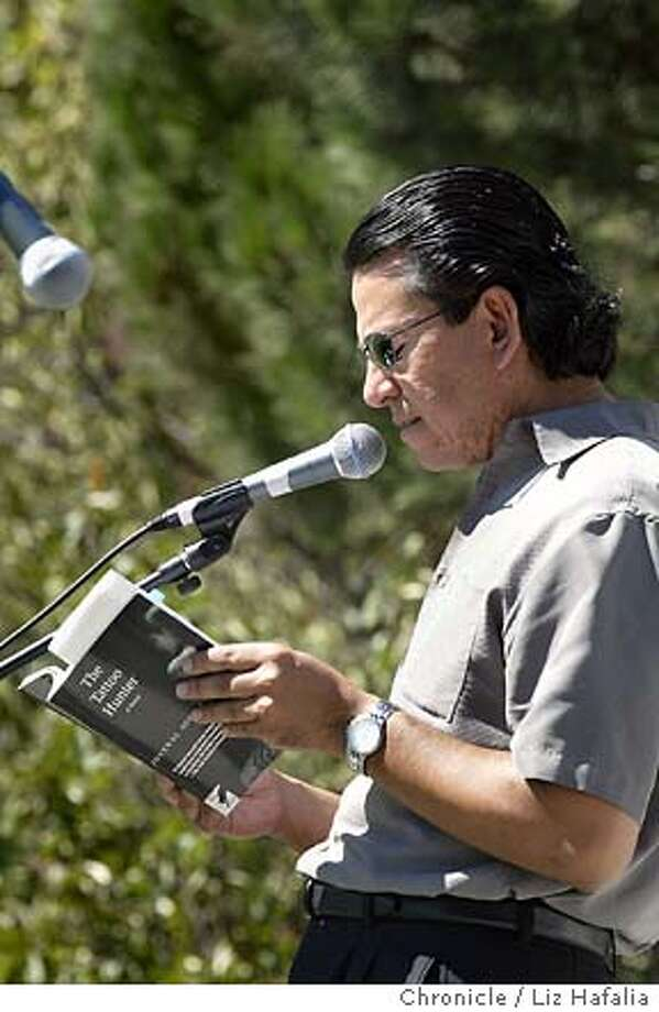 'Litquake' authors at the festival of events in Yerba Buena gardens. Author Juvenal Acosta reading at the festival. Shot on 9/20/03 in San Francisco. LIZ HAFALIA / The Chronicle Photo: LIZ HAFALIA
