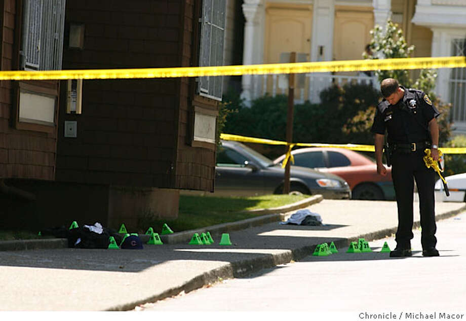 SFPD Officers and Investigators on the scene investigating the surrounding area. A triple shooting, no deaths, reported this morning at 8:53. 1 Friendship Ct. in the Western Addition neighborhood.This following a night of violence in the city. Photographed in, San Francisco, Ca, on 6/14/07. Photo by: Michael Macor/ The Chronicle Photo: Michael Macor