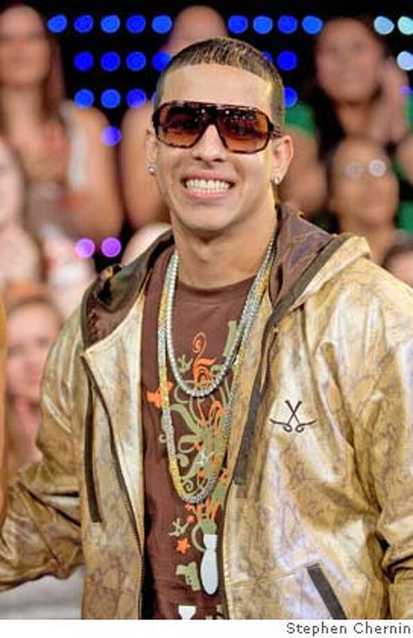 Daddy Yankee appears on MTV's Total Request Live, Wednesday, May 30, 2007 at MTV Times Square studios in New York. (AP Photo/STephen Chernin) Photo: STEPHEN CHERNIN