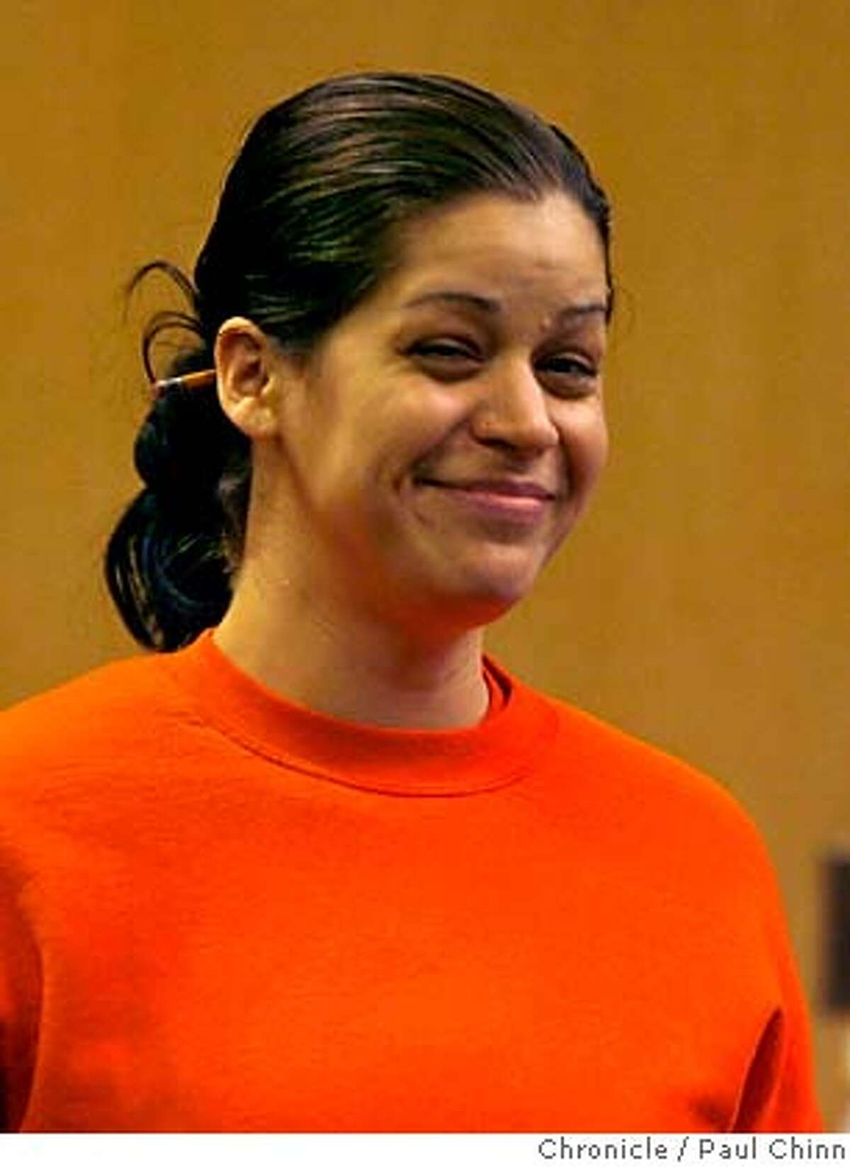 Maria Nelson smiles as she enters the courtroom before she was sentenced to three years probation in San Francisco, Calif. on Wednesday, June 6, 2007. Nelson was convicted of stealing the identity of Karen Lodrick. PAUL CHINN/The Chronicle **Maria Nelson, Karen Lodrick