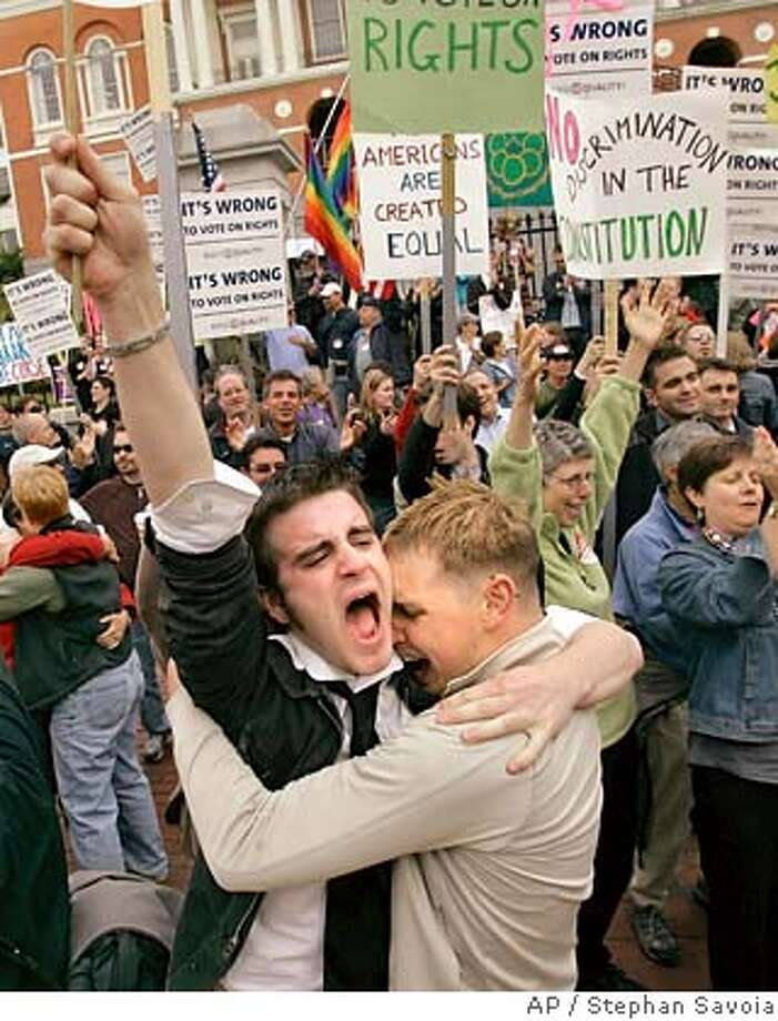 Greg Kimball, left, of Manchester, Mass., and his partner of five months, Brian O'Connor hug as they celebrate after Massachusetts lawmakers voted to kill a proposed constitutional amendment to ban gay marriage at the Statehouse in Boston, Thursday afternoon, June 14, 2007. Kimball said he and O'Connor plan to marry now that the legal issue is settled. (AP Photo/Stephan Savoia) Photo: Stephan Savoia