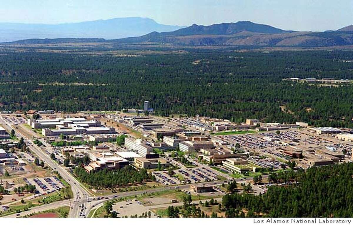 ** FILE ** The Los Alamos National Laboratory in Los Alamos, N.M., is shown in this 1995 aerial file photo. Despite a string of security lapses and allegations of fraud and mismanagement, the University of California was awarded the government contract Wednesday, Dec. 21, 2005, to continue managing the Los Alamos laboratory that built the atom bomb. Because of the scandals at Los Alamos, the government contract to run the nation's pre-eminent nuclear lab had been put out to bid this year for the first time in the lab's 63-year history. (AP Photo/Los Alamos National Laboratory, File) ** ** FILE 1995 AERIAL LOS ALAMOS NATIONAL LABORATORY PHOTO;