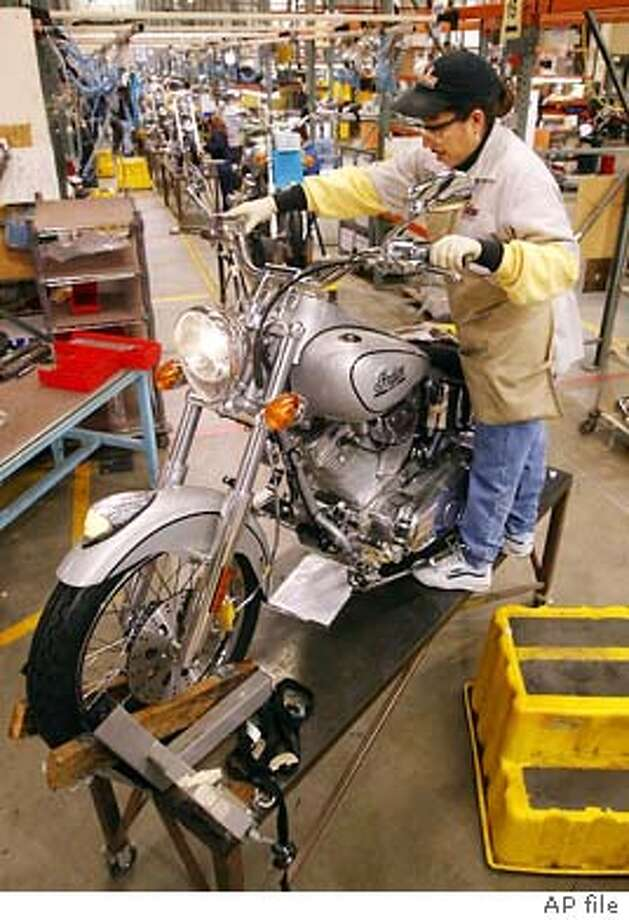 ** FILE ** Christina Sandoval performs a quality control inspection on an Indian Scout at the end of the assembly line in Gilroy, Calif., Jan. 30, 2002. announced Monday Sept. 22, 2003, that it has ceased production effective immediately in order to conserve cash and preserve its assets. The Company also announced that it has laid off its workforce. (AP Photo/Mike Fiala) Photo: MIKE FIALA