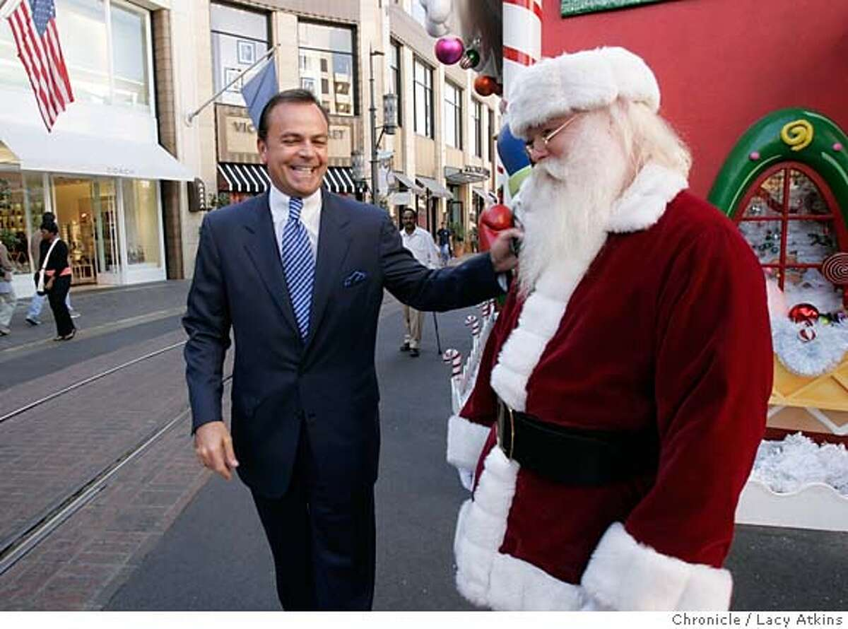 """Developer Rick Caruso laughs as he says hello to Santa at """" The Grove """" shopping center in Los Angeles, Dec. 12, 2005. Developer Rick Caruso tours four of his shopping complex in the in Los Angeles area, Dec 12, 2005. Caruso is who to develop a complex in Albany. Photo By Lacy Atkins MANDATORY CREDIT FOR PHOTOG AND SF CHRONICLE/ -MAGS OUT"""