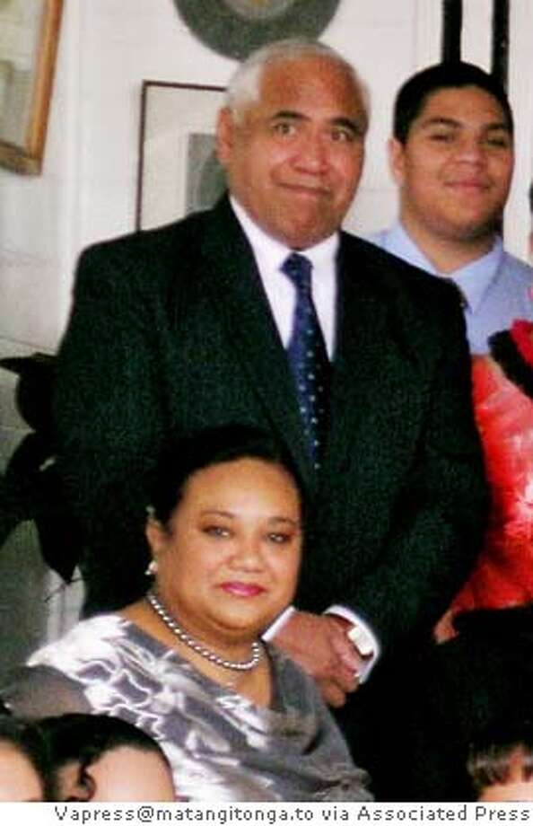 ** FILE ** Tongan Prince Tu'ipelehake and his wife, Princess Kaimana, appear at Tonga King Taufa'ahau Tupou IV's 88th birthday party at the Royal Palace, in Nuku'alofa, Tonga, July 4, 2006. Edith Delgado was convicted Thursday, June 14, 2007, of misdemeanor vehicular manslaughter without gross negligence for causing a freeway crash that killed three people, including two members of Tonga's royal family. She was acquitted of more serious charges. Prince Tu'ipelehake, 55, Princess Kaimana, 46, and their driver, Vinisia Hefa, 36, were killed in a vehicle accident in Menlo Park, Calif., on July 5, 2006. The boy at upper right is unidentified. (AP Photo/VAPRESS@MATANGITONGA.TO, Linny Folau) ** NO SALES ** JULY 4, 2006 FILE PHOTO. NO SALES Photo: Linny Folau