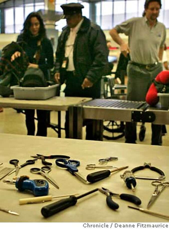 travel22_099_df.JPG  Oakland International Airport displayed items which will now be allowed on board an aircraft. Items include scissors with a cutting edge of 4 inches or less and tools such as screwdrivers, wrenches and pliers smaller that seven inches.  Event in Oakland on 12/21/05.  Deanne Fitzmaurice / The Chronicle Photo: Deanne Fitzmaurice