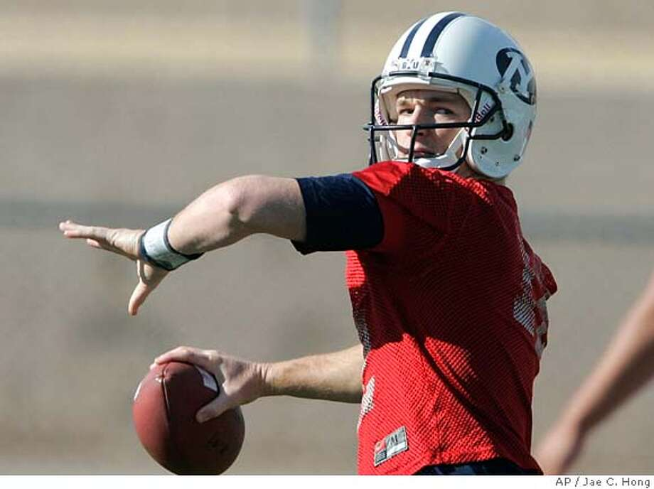Brigham Young quarterback John Beck throws a pass during football practice in Las Vegas, Tuesday, Dec. 20, 2005. BYU will face California in the Las Vegas Bowl college football game in Las Vegas on Thursday. (AP Photo/Jae C. Hong) A DEC. 20, 2005, PHOTO; EFE OUT Photo: JAE C. HONG