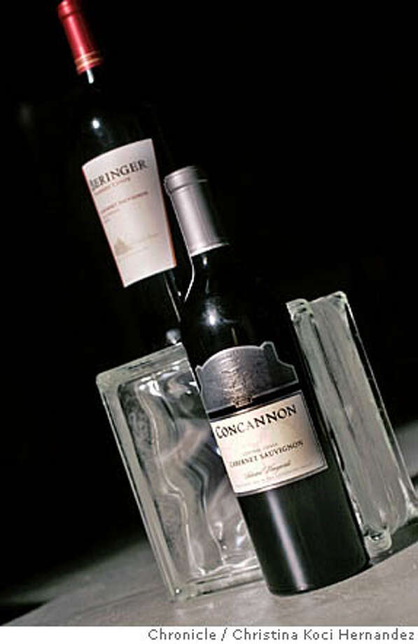 CHRISTINA KOCI HERNANDEZ/CHRONICLE  For the Bargain Wines column of Dec. 22, we need the ever-popular bottle shot of:  2003 Beringer Founders' Estate California Cabernet Sauvignon  and  2003 Concannon Central Coast Cabernet Sauvignon Photo: CHRISTINA KOCI HERNANDEZ