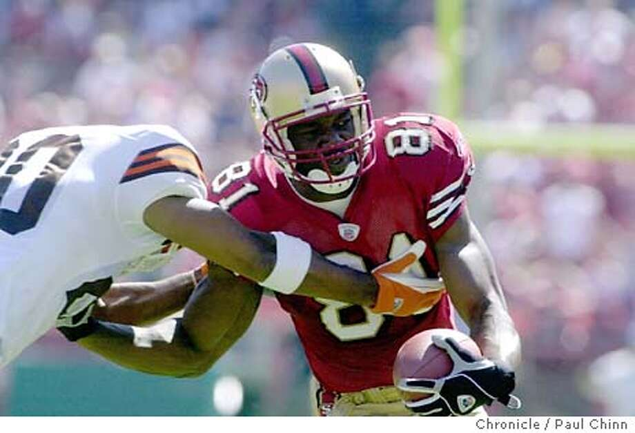 49ers014_pc.jpg San Francisco 49ers Terrell Owens is taken down by Earl Little after making a first down against the Cleveland Browns at Candlestick Park in San Francisco on 9/21/03. First quarter PAUL CHINN / The Chronicle MANDATORY CREDIT FOR PHOTOG AND SF CHRONICLE/ -MAGS OUT Photo: PAUL CHINN