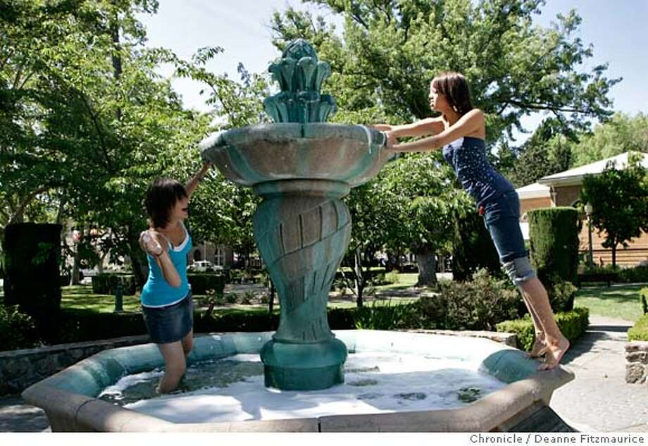 sonoma_0028_df.jpg  (l to r) Katie Souza (cq), 14, and Lauren Pena (cq), 15, both from Sonoma play the water and suds in the Italian Garden fountain on Sonoma Square. Soap was put in the fountain as a senior graduate prank. Sonoma may have to cut down on water usage. Photographed in Sonoma on 6/14/07. Deanne Fitzmaurice / The Chronicle Mandatory credit for photographer and San Francisco Chronicle. No Sales/Magazines out. Photo: Deanne Fitzmaurice