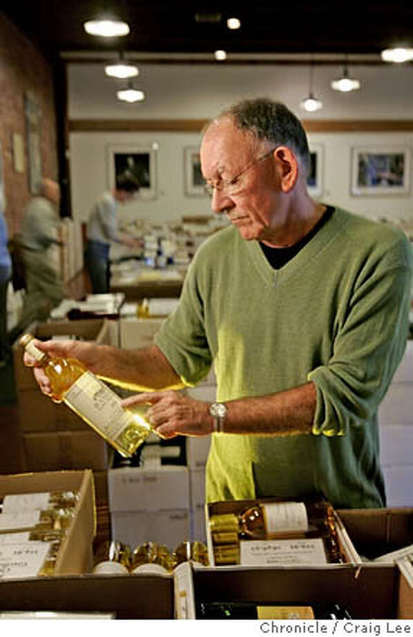 KERMIT13_068_cl.JPG  Kermit Lynch, owner of Kermit Lynch Wine Merchant, a wine shop in Berkeley. He sells wines mostly from France. Photo of Kermit Lynch in his wine shop. The bottle of wine he is holding is a white wine called Domaine Tempier. Event on 9/27/05 in San Francisco. Craig Lee / The Chronicle Ran on: 10-02-2005 MANDATORY CREDIT FOR PHOTOG AND SF CHRONICLE/ -MAGS OUT Photo: Craig Lee