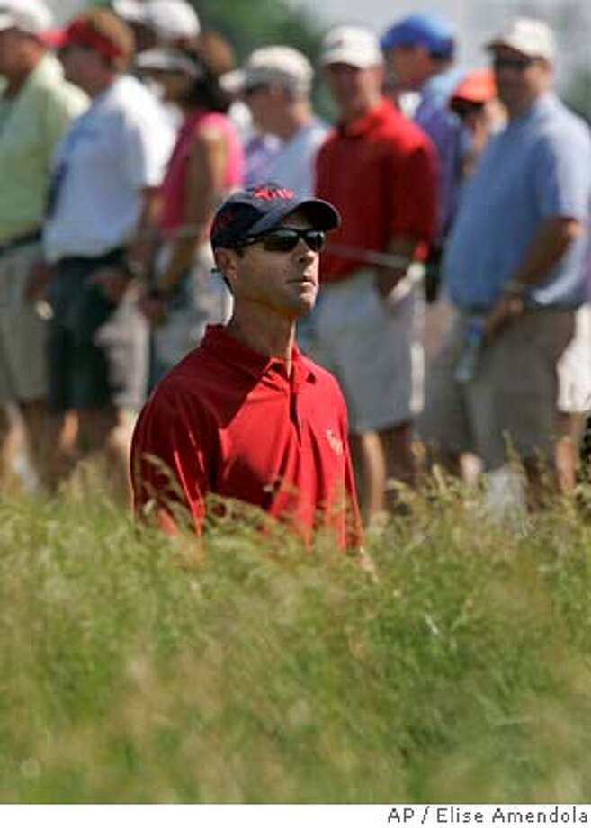 Jeff Brehaut watches his shot out of the rough on the 16th fairway in preparation for the 107th U.S. Open Golf Championship at the Oakmont Country Club in Oakmont, Pa., Monday, June 11, 2007. Brehaut first tried to qualify for the U.S. Open at the age of 18. Twenty-one years after he turned pro, he finally made it to his first major. (AP Photo/Elise Amendola) Photo: Elise Amendola