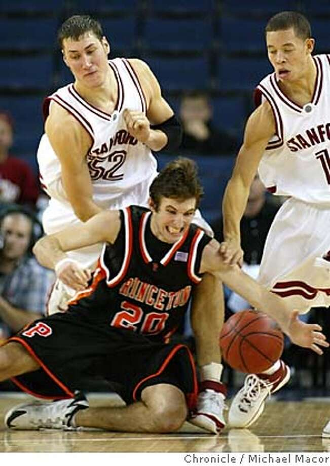 2nd half action, Princeton's 20-Luke Owings under pressure from Stanford's 52-Matt Haryasz and 1-Mitch Johnson. Stanford wins 58-34.The Pete Newel Challenge, College Basketball tournament. Game 1-Stanford vs. Princeton. Event in Oakland, Ca on 12/21/05. Photo by: Michael Macor / San Francisco Chronicle Photo: Michael Macor