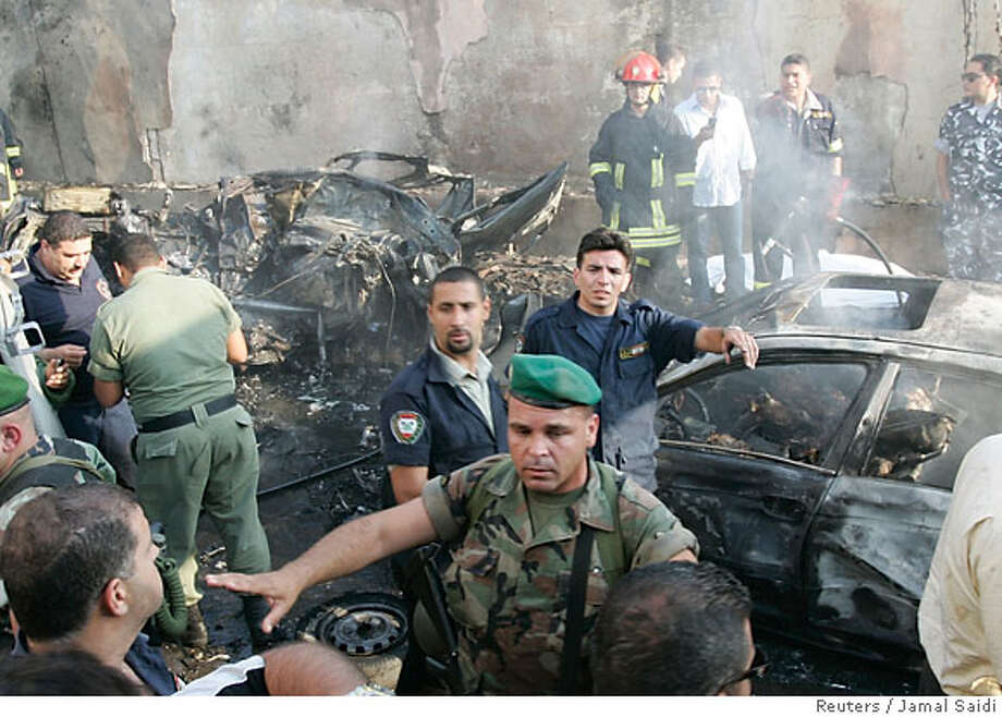 Lebanese soldiers secure an explosion site in Beirut June 13, 2007. A blast in Beirut on Wednesday killed anti-Syrian MP Walid Eido, one of his sons and two other people who were with him, security sources said. REUTERS/Jamal Saidi (LEBANON) Photo: JAMAL SAIDI