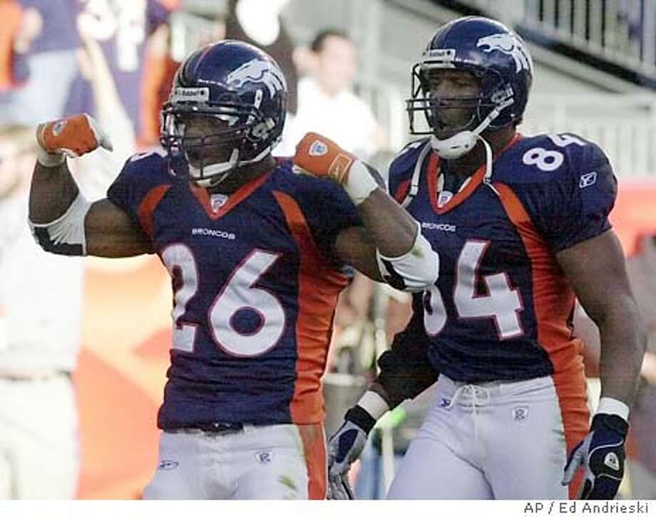 Denver Broncos running back Clinton Portis (26) celebrates with teammate Shannon Sharpe after a 3-yard touchdown run in the first quarter against the Kansas City Chiefs in Denver, Sunday, Dec. 15, 2002. (AP Photo/Ed Andrieski) CAT Photo: ED ANDRIESKI
