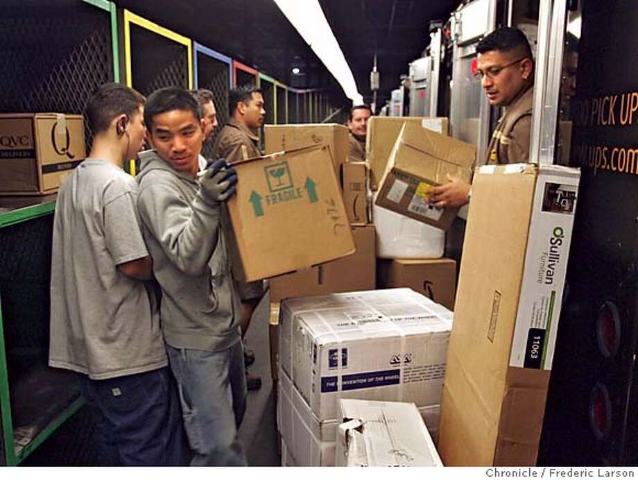 UPS_0447_fl.jpg UPS will have its busiest day Tuesday, packaging, shipping and delivering an estimated 20 million packages at the UPS facility in South San Francisco.  12/20/05 San Francisco CA Frederic Larson San Francisco Chronicle Photo: Frederic Larson