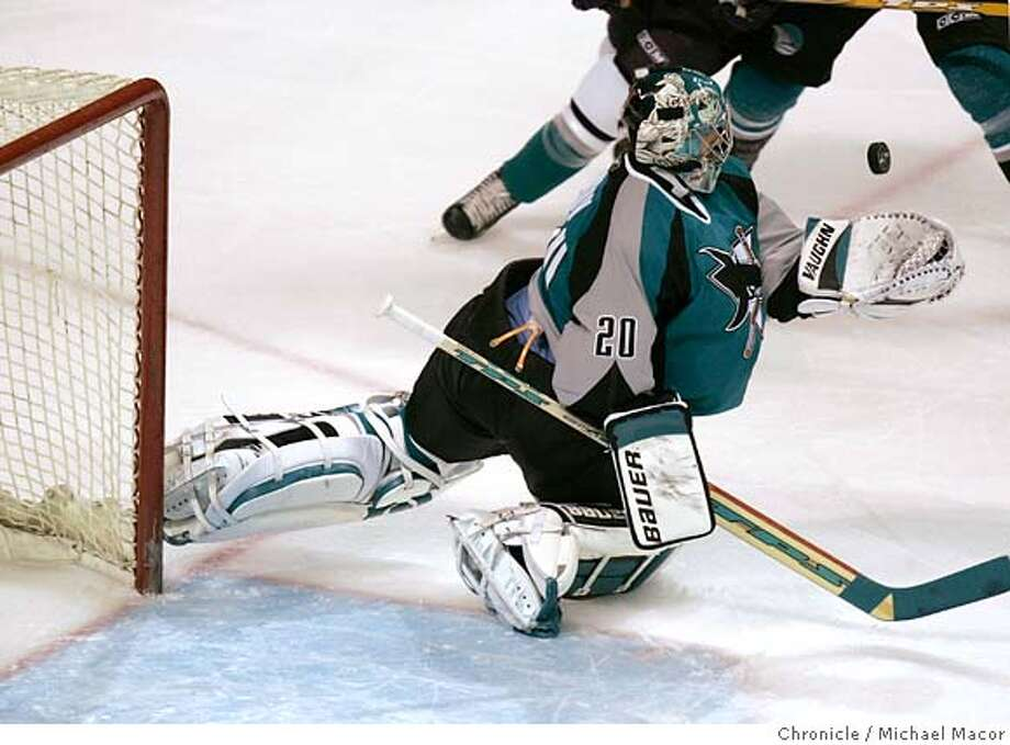 Sharks goalie Evgeni Nabokov makes a first period stop. NHL, San Jose Sharks vs. Mighty Ducks of Anaheim. Event in San Jose, Ca on 12/20/05. Photo by: Michael Macor / San Francisco Chronicle Photo: Michael Macor